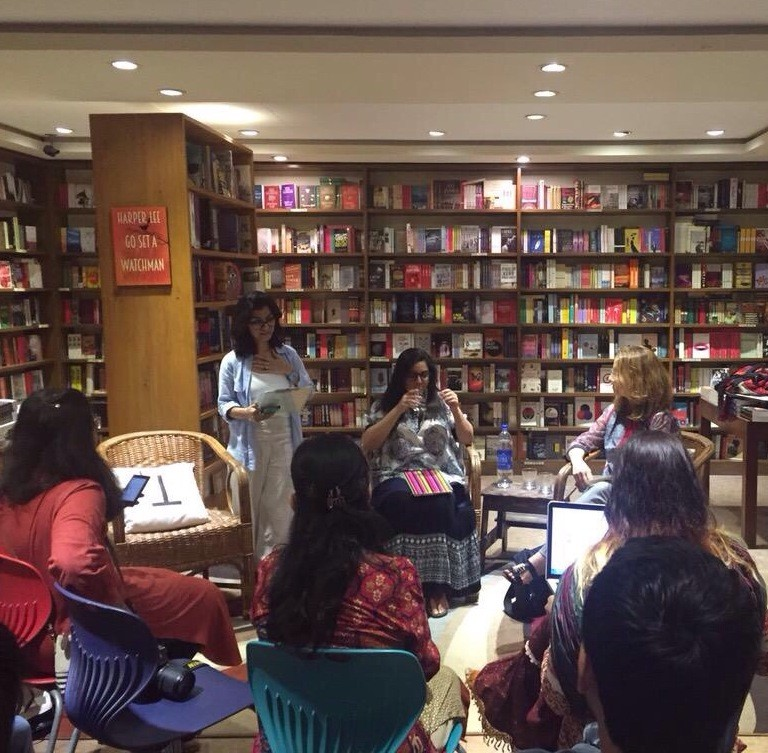 Aysha Raja, owner of the Last Word, compering the event. On her right are Nabiha Meher Shaikh and Susan Benesch